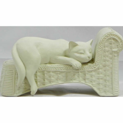 Cat Lying in Chaise Longue in Cream